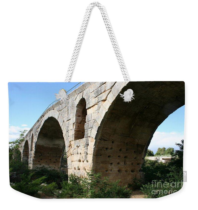 Roman Stonebridge Weekender Tote Bag featuring the photograph Roman Bridge Pont St. Julien by Christiane Schulze Art And Photography