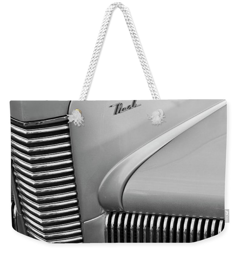 1940 Chevrolet Nash Weekender Tote Bag featuring the photograph 1940 Nash Grille by Jill Reger