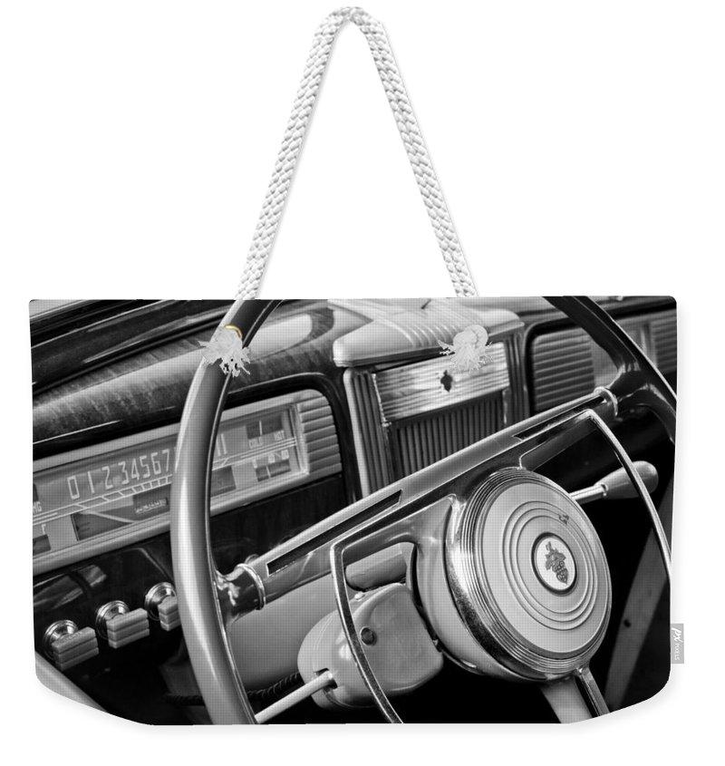 1941 Packard Steering Wheel Weekender Tote Bag featuring the photograph 1941 Packard Steering Wheel by Jill Reger