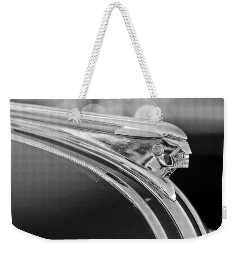 1948 Pontiac Streamliner Woodie Station Wagon Hood Ornament Weekender Tote Bag featuring the photograph 1948 Pontiac Streamliner Woodie Station Wagon Hood Ornament by Jill Reger