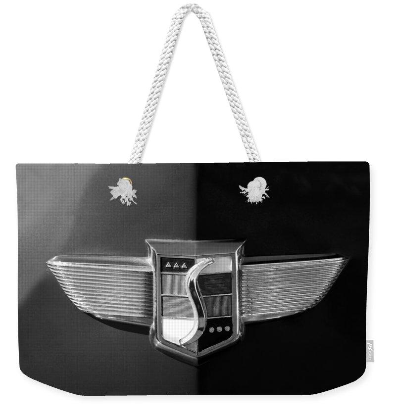 1948 Studebaker Emblem Weekender Tote Bag featuring the photograph 1948 Studebaker Emblem by Jill Reger