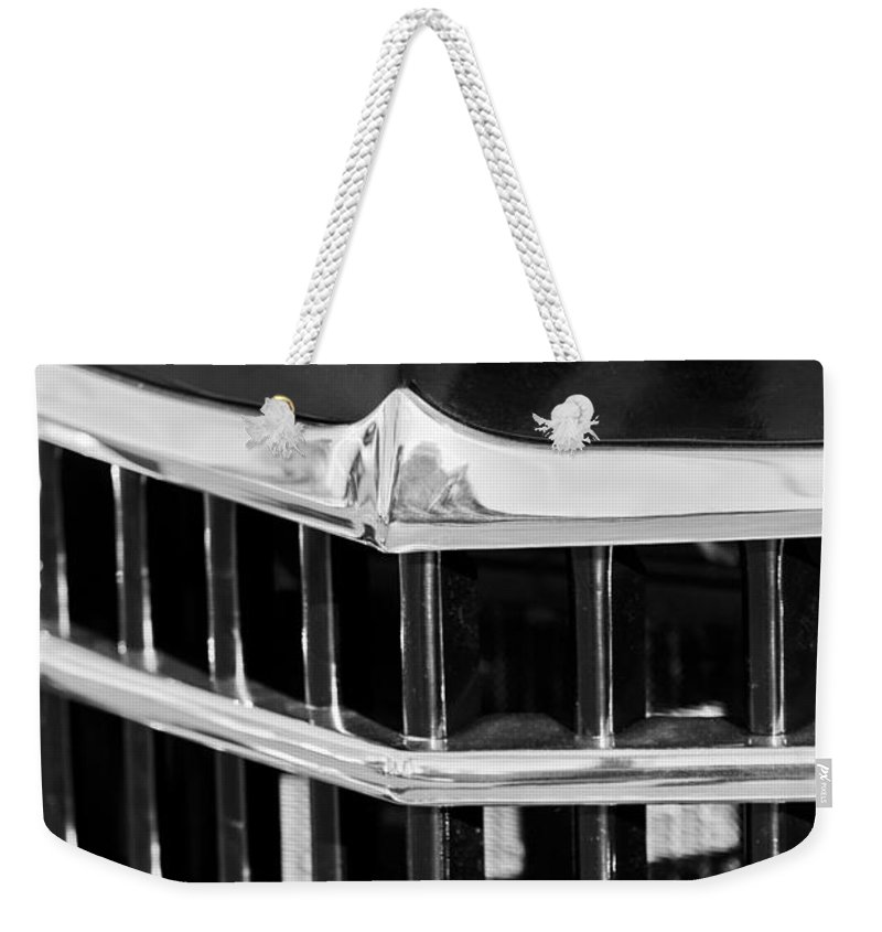 1950 Willys Jeepster Grille Emblem Weekender Tote Bag featuring the photograph 1950 Willys Jeepster Grille Emblem by Jill Reger
