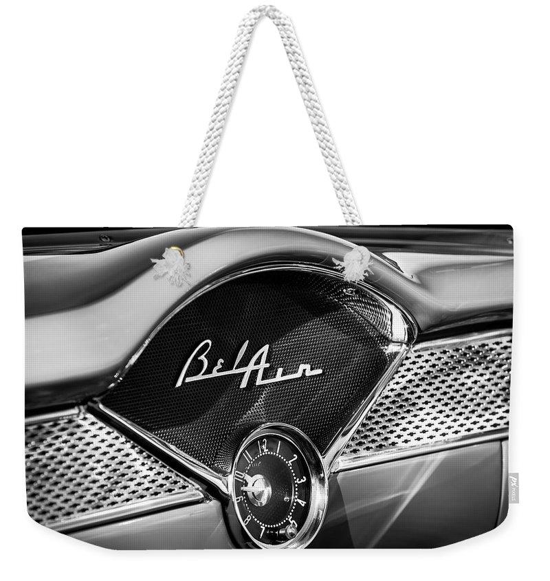 1955 Chevrolet Belair Dashboard Emblem Clock Weekender Tote Bag featuring the photograph 1955 Chevrolet Belair Dashboard Emblem Clock by Jill Reger