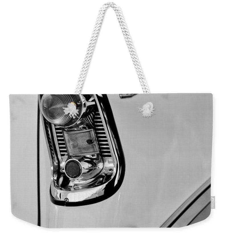 1956 Chevrolet Belair Taillight Emblem Weekender Tote Bag featuring the photograph 1956 Chevrolet Belair Taillight Emblem by Jill Reger
