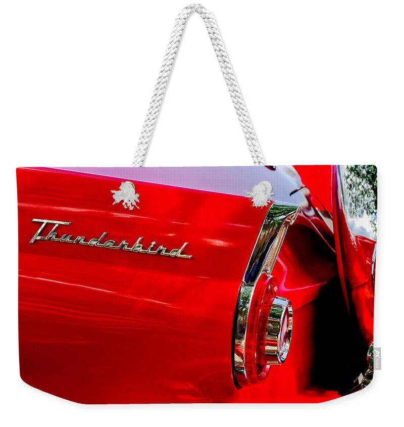 1956 Ford Thunderbird Taillight Emblem Weekender Tote Bag featuring the photograph 1956 Ford Thunderbird Taillight Emblem by Jill Reger