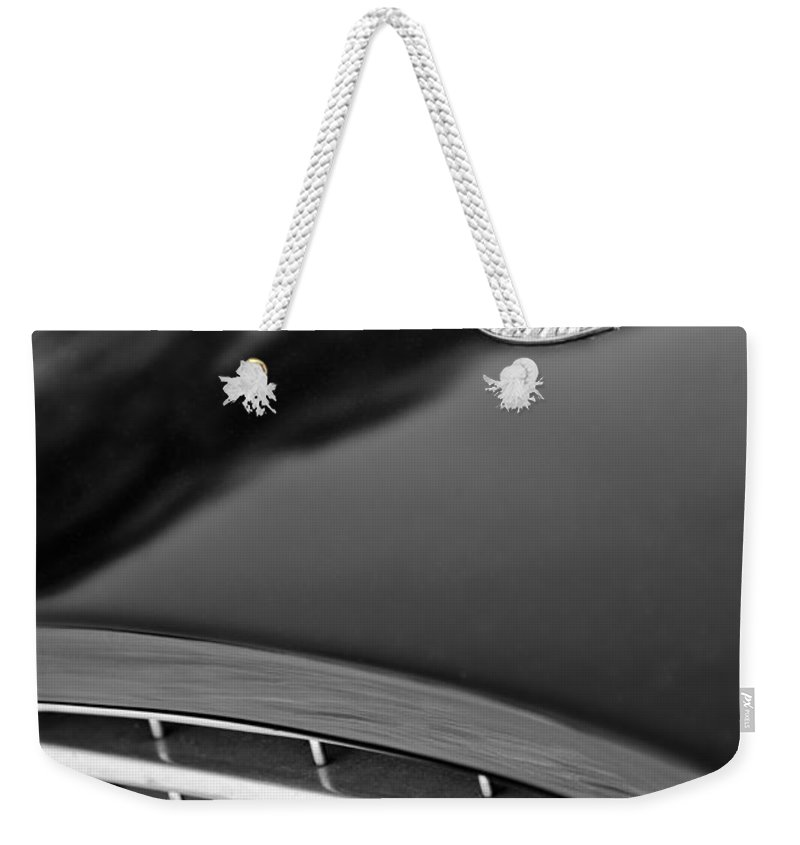 1957 Ac Ace Bristol Roadster Hood Emblem Weekender Tote Bag featuring the photograph 1957 Ac Ace Bristol Roadster Hood Emblem by Jill Reger
