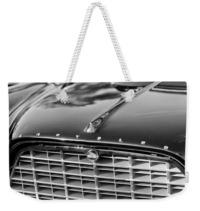 1957 Chrysler 300c Grille Emblem Weekender Tote Bag featuring the photograph 1957 Chrysler 300c Grille Emblem by Jill Reger