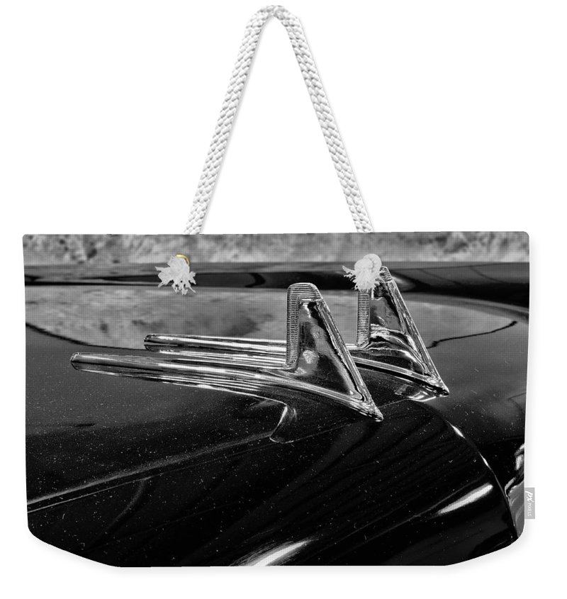 1957 Weekender Tote Bag featuring the photograph 1957 Lincoln Capri Hood Ornament by Michael Gordon