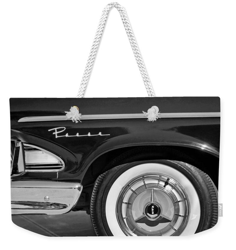1958 Edsel Pacer Wheel Emblem Weekender Tote Bag featuring the photograph 1958 Edsel Pacer Wheel Emblem by Jill Reger