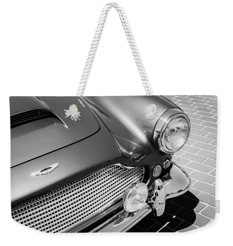 1960 Aston Martin Db4 Series Ii Grille Weekender Tote Bag featuring the photograph 1960 Aston Martin Db4 Series II Grille by Jill Reger