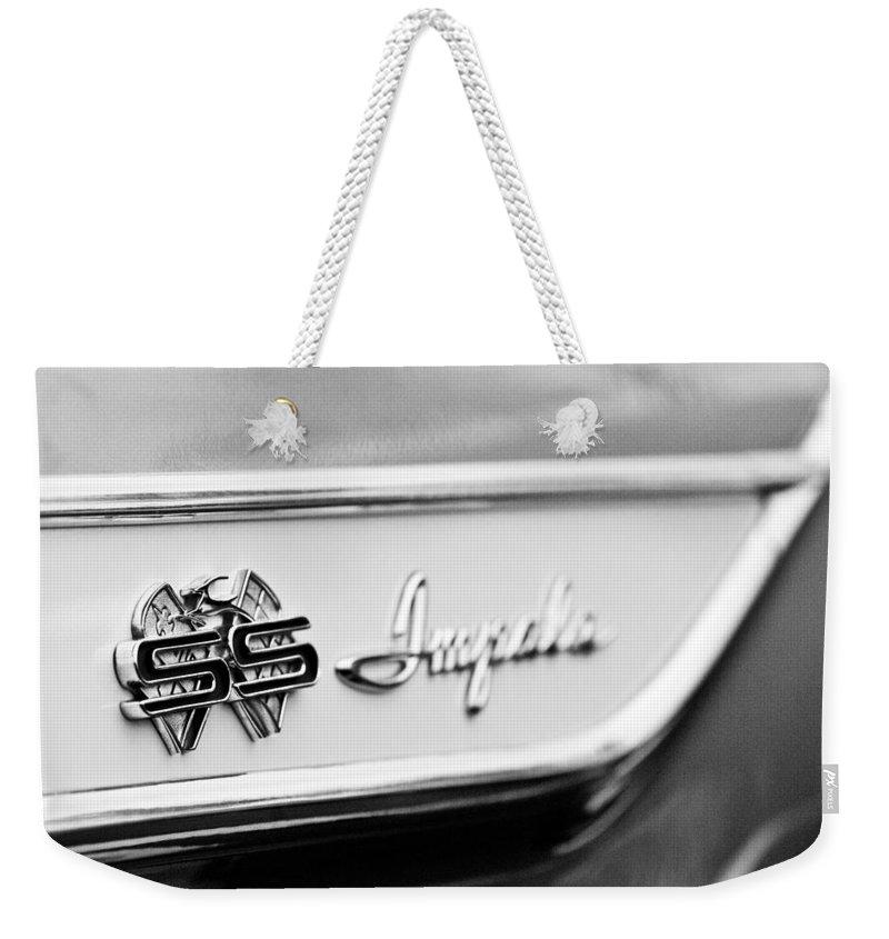 1961 Chevrolet Impala Ss Emblem Weekender Tote Bag featuring the photograph 1961 Chevrolet Impala Ss Emblem by Jill Reger
