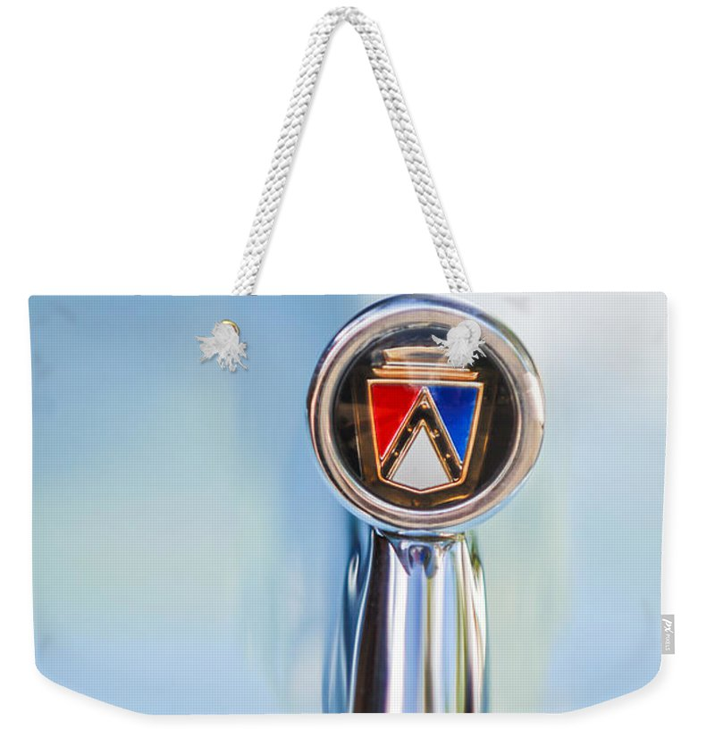 1963 Ford Falcon Futura Convertible Hood Ornament Weekender Tote Bag featuring the photograph 1963 Ford Falcon Futura Convertible Hood Ornament by Jill Reger