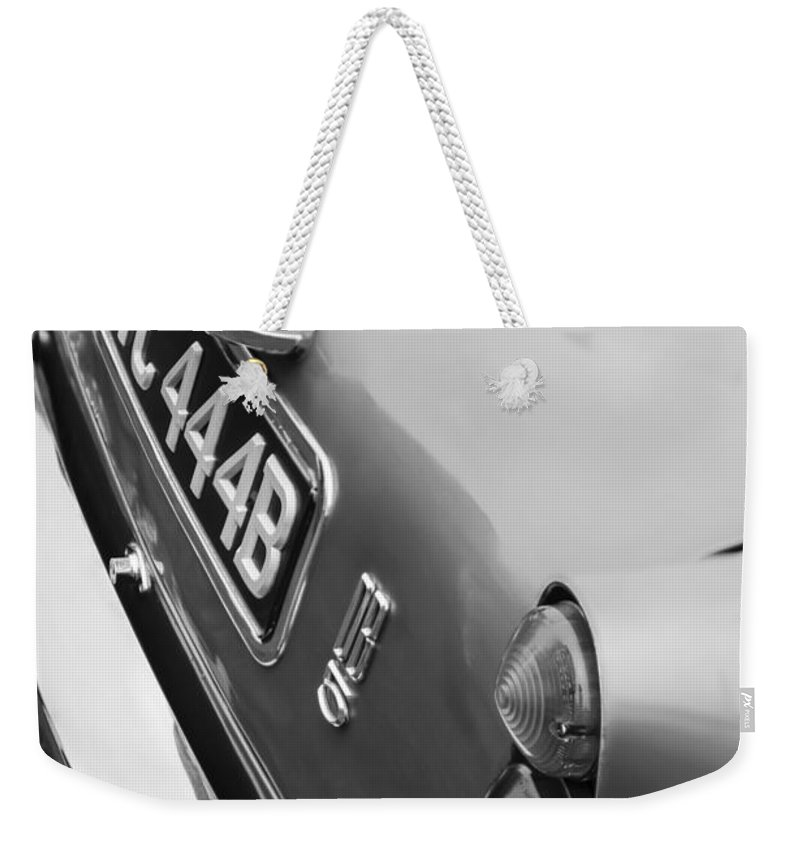 1964 Aston Martin Db5 Coupe' Taillight Weekender Tote Bag featuring the photograph 1964 Aston Martin Db5 Coupe' Taillight by Jill Reger