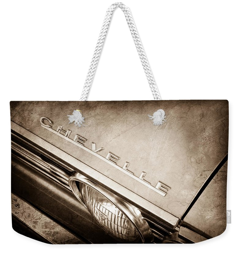 1967 Chevrolet Chevelle Hood Emblem Weekender Tote Bag featuring the photograph 1967 Chevrolet Chevelle Hood Emblem by Jill Reger