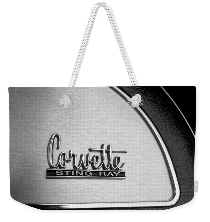 1967 Chevrolet Corvette Glove Box Emblem Weekender Tote Bag featuring the photograph 1967 Chevrolet Corvette Glove Box Emblem by Jill Reger