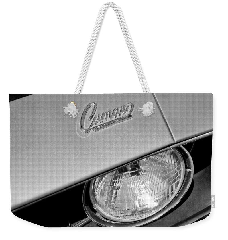 1969 Chevrolet Camaro Headlight Emblem Weekender Tote Bag featuring the photograph 1969 Chevrolet Camaro Headlight Emblem by Jill Reger