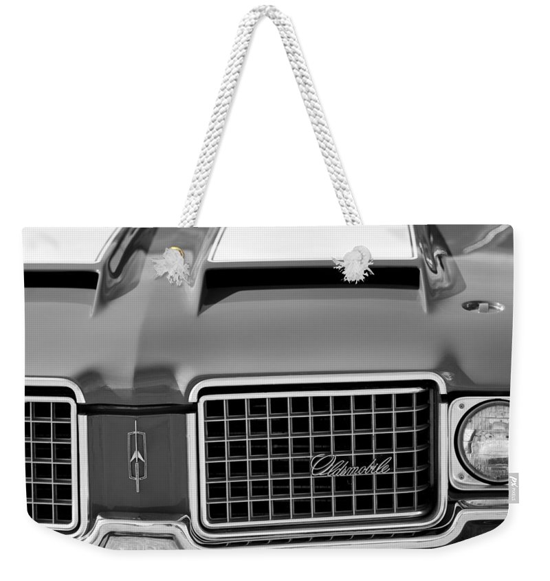 1972 Oldsmobile Grille Weekender Tote Bag featuring the photograph 1972 Oldsmobile Grille by Jill Reger