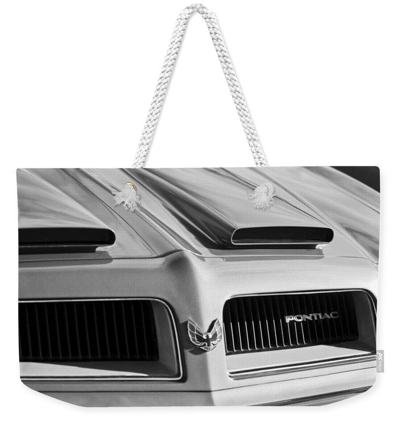 1974 Pontiac Firebird Grille Emblem Weekender Tote Bag featuring the photograph 1974 Pontiac Firebird Grille Emblem by Jill Reger