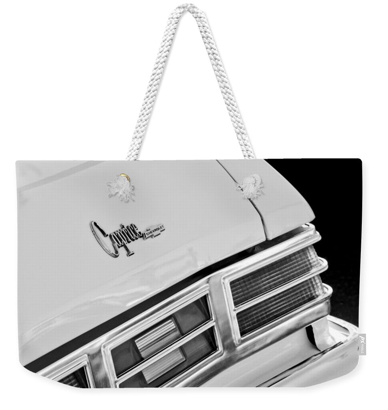 1975 Chevrolet Caprice Classic Convertible Taillights Emblem Weekender Tote Bag featuring the photograph 1975 Chevrolet Caprice Classic Convertible Taillights Emblem by Jill Reger