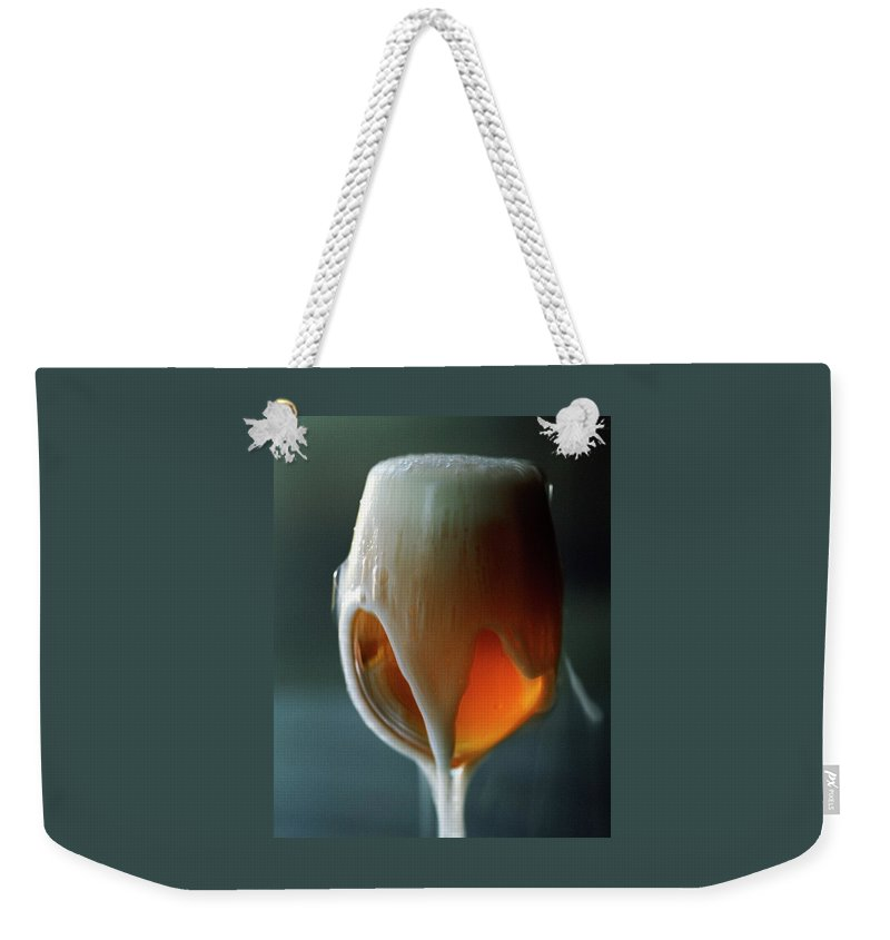 Beverage Weekender Tote Bag featuring the photograph A Glass Of Beer by Romulo Yanes