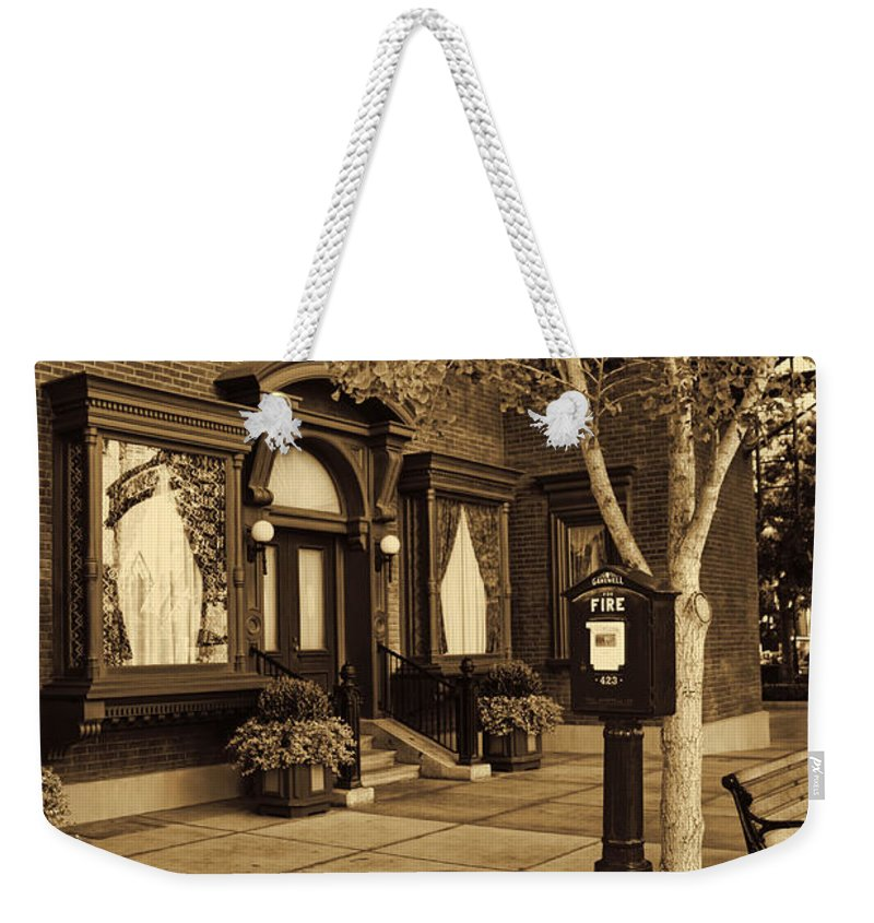 Disney California Adventure Weekender Tote Bag featuring the photograph A Moment In Time by Tommy Anderson