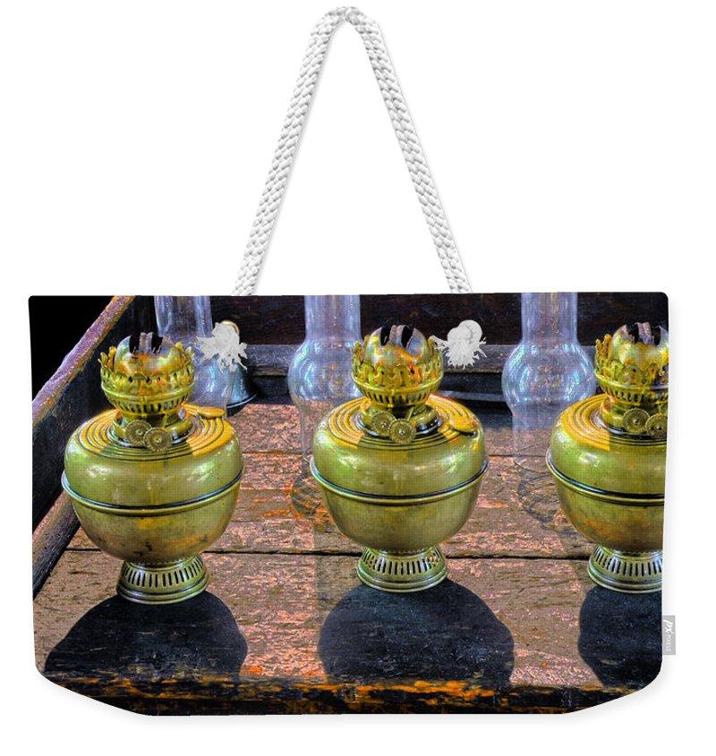 Kerosene Lamps Weekender Tote Bag featuring the photograph Antique Kerosene Lamps by Dave Mills