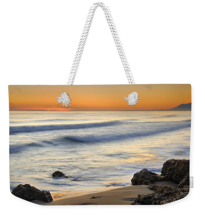 Water Weekender Tote Bag featuring the photograph Artola Beach by Guido Montanes Castillo