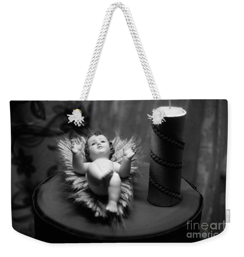 Christmas Weekender Tote Bag featuring the photograph Baby Jesus by Gaspar Avila
