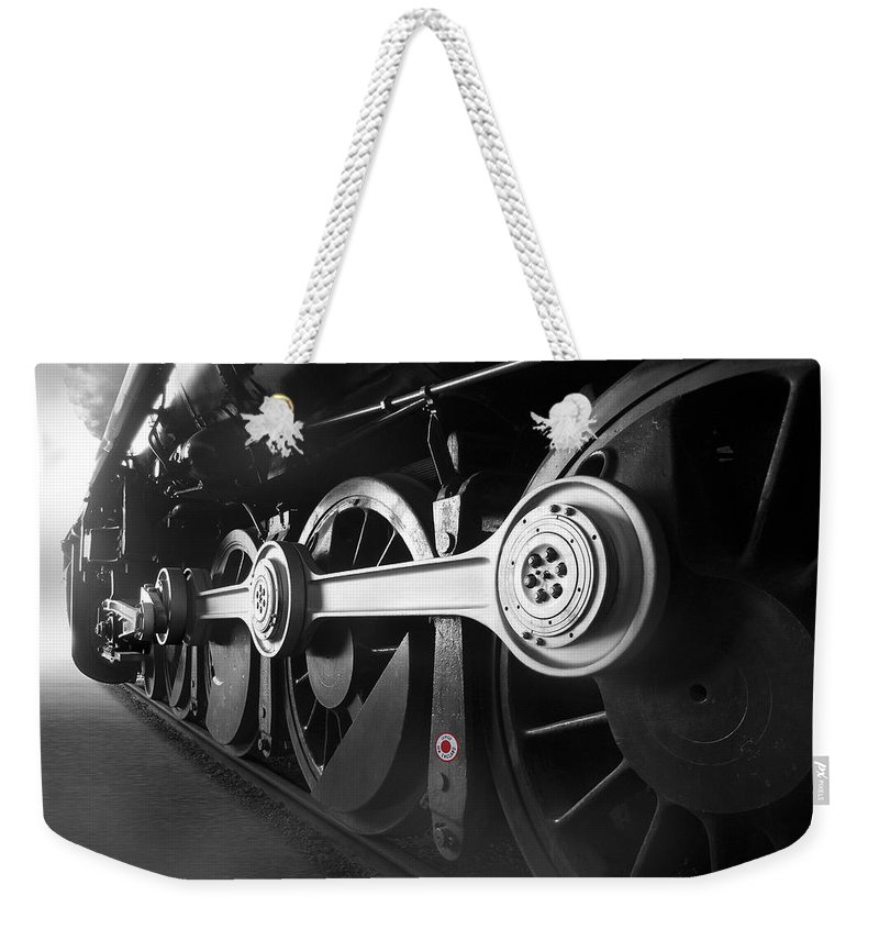 Transportation Weekender Tote Bag featuring the photograph Big Wheels by Mike McGlothlen