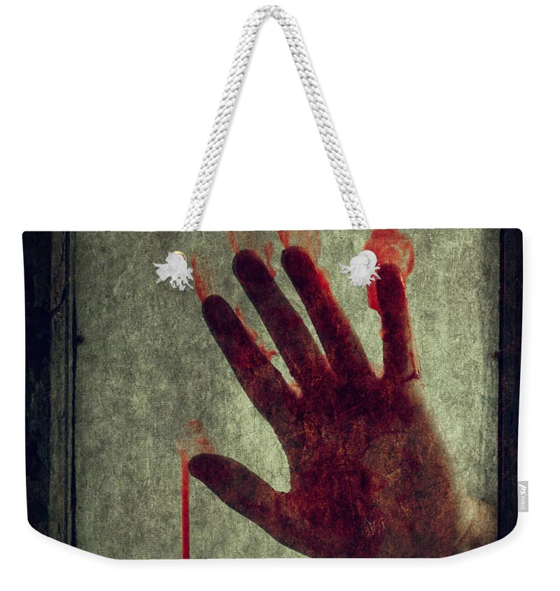 Hand Weekender Tote Bag featuring the photograph Bloody Hand On Window by Lee Avison