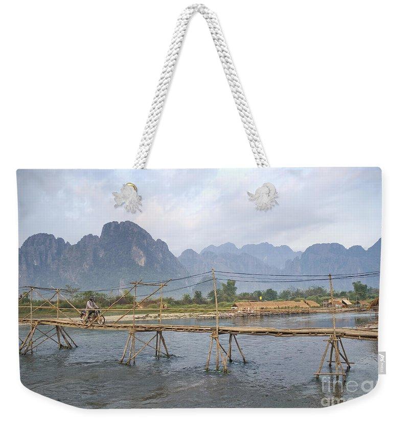 Bamboo Weekender Tote Bag featuring the photograph Bridge In Vang Vieng Laos by Jacek Malipan