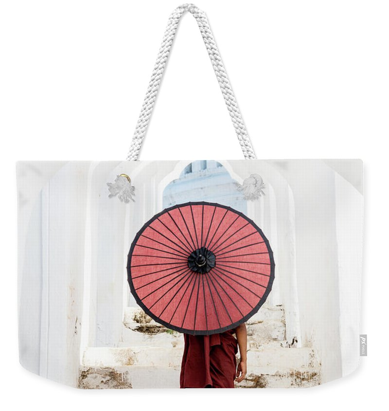 Steps Weekender Tote Bag featuring the photograph Buddhist Monk Walking Along Temple by Martin Puddy
