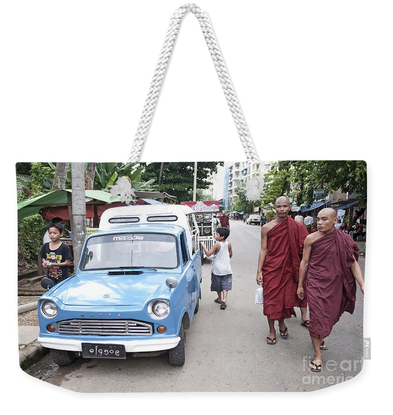 Buddhist Weekender Tote Bag featuring the photograph Buddhist Monks In Yangon Street Myanmar by Jacek Malipan
