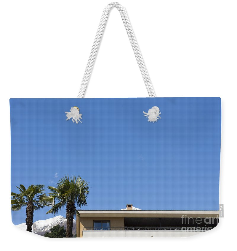 Building Weekender Tote Bag featuring the photograph Building And Palm Trees by Mats Silvan