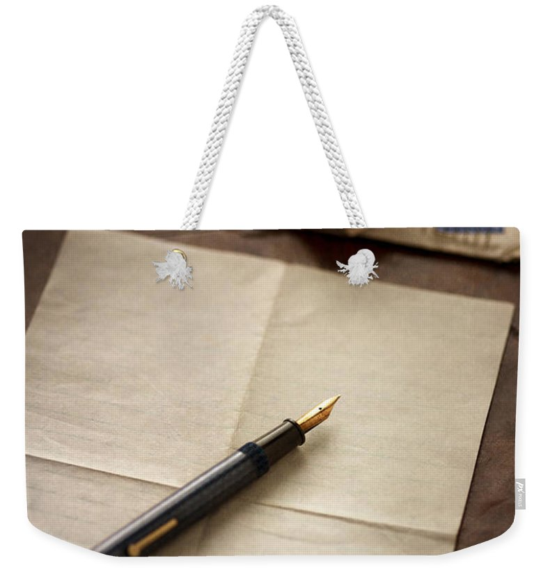 Letter Weekender Tote Bag featuring the photograph Bundle Of Vintage Letters With Fountain Pen by Lee Avison