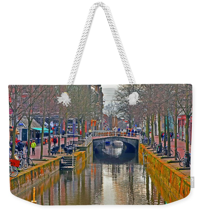 Travel Weekender Tote Bag featuring the photograph Canal Of Delft by Elvis Vaughn