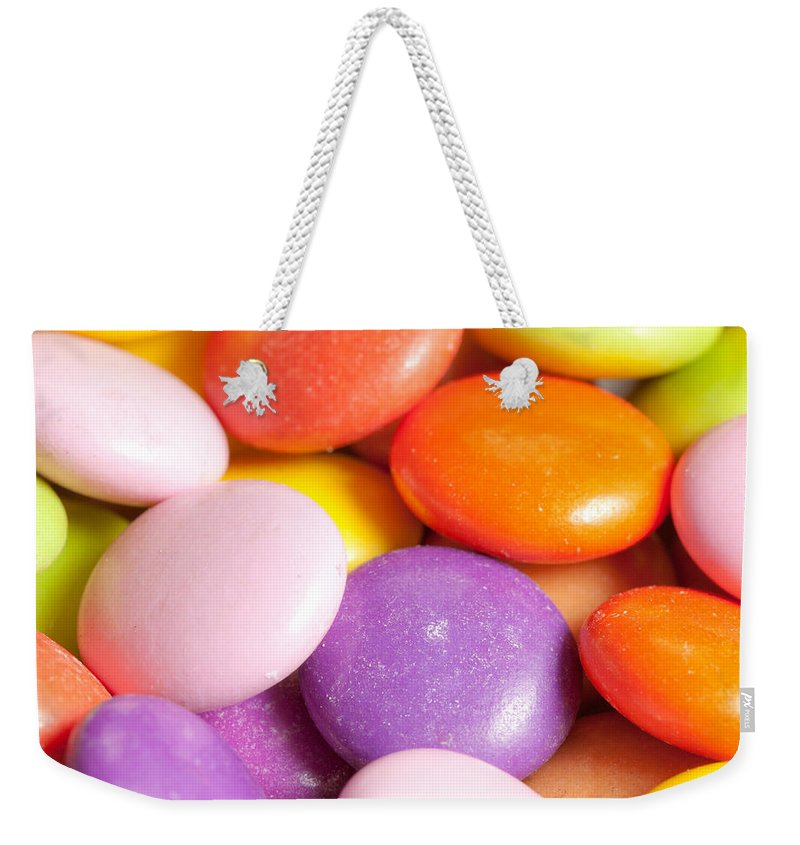 Additives Weekender Tote Bag featuring the photograph Candy Background by Tom Gowanlock