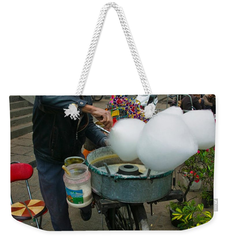 Photography Weekender Tote Bag featuring the photograph Candy Floss Vendor Selling Cotton by Panoramic Images