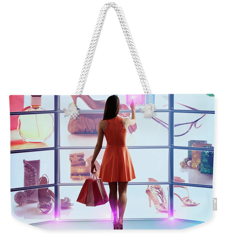 Internet Weekender Tote Bag featuring the photograph Caucasian Woman Shopping Online by Colin Anderson Productions Pty Ltd
