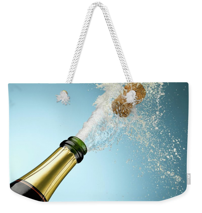 Celebration Weekender Tote Bag featuring the photograph Champagne And Cork Exploding From Bottle by Andy Roberts