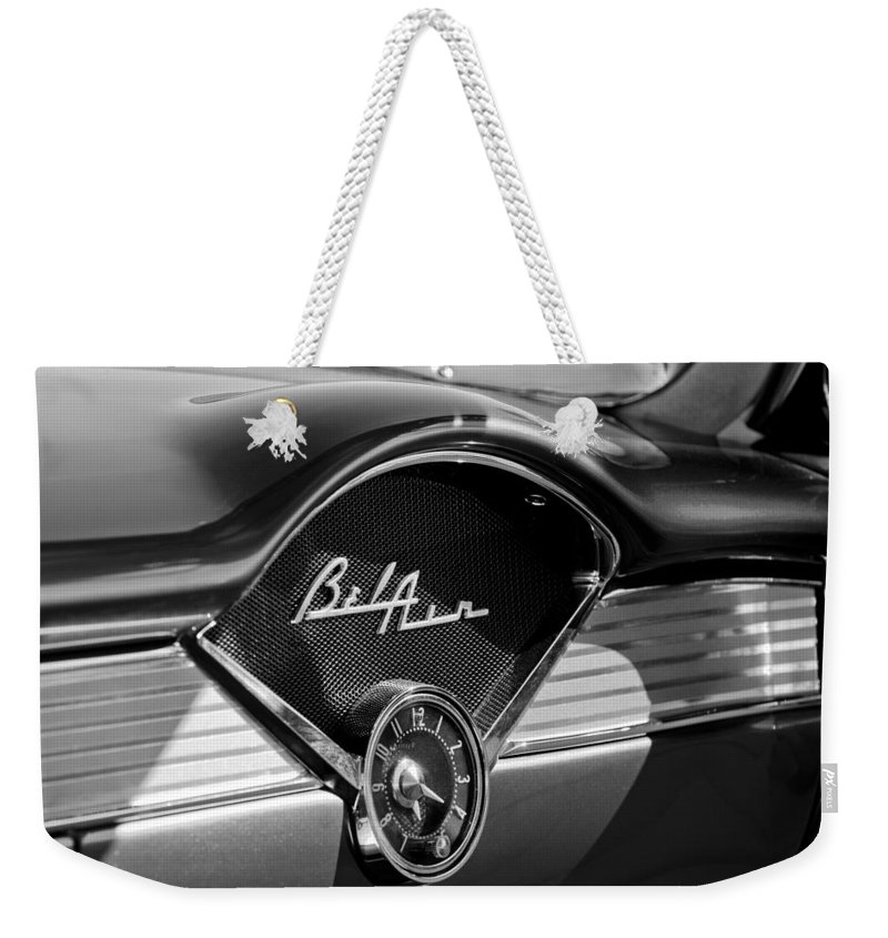 Chevrolet Belair Dashboard Clock And Emblem Weekender Tote Bag featuring the photograph Chevrolet Belair Dashboard Clock And Emblem by Jill Reger