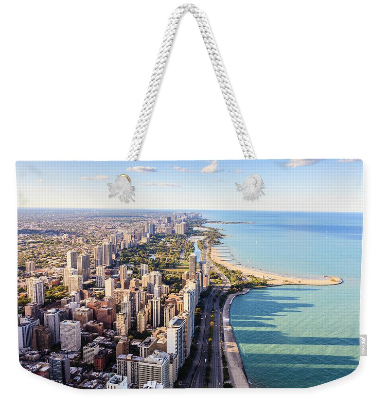 Water's Edge Weekender Tote Bag featuring the photograph Chicago Lakefront Skyline by Fraser Hall