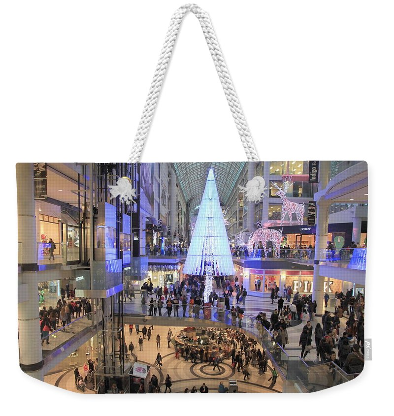 Shopping Weekender Tote Bag featuring the photograph Christmas Shopping In Toronto by Valentino Visentini