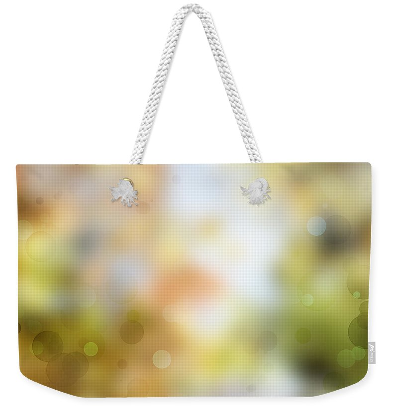Yellow Weekender Tote Bag featuring the photograph Circles Background by Les Cunliffe
