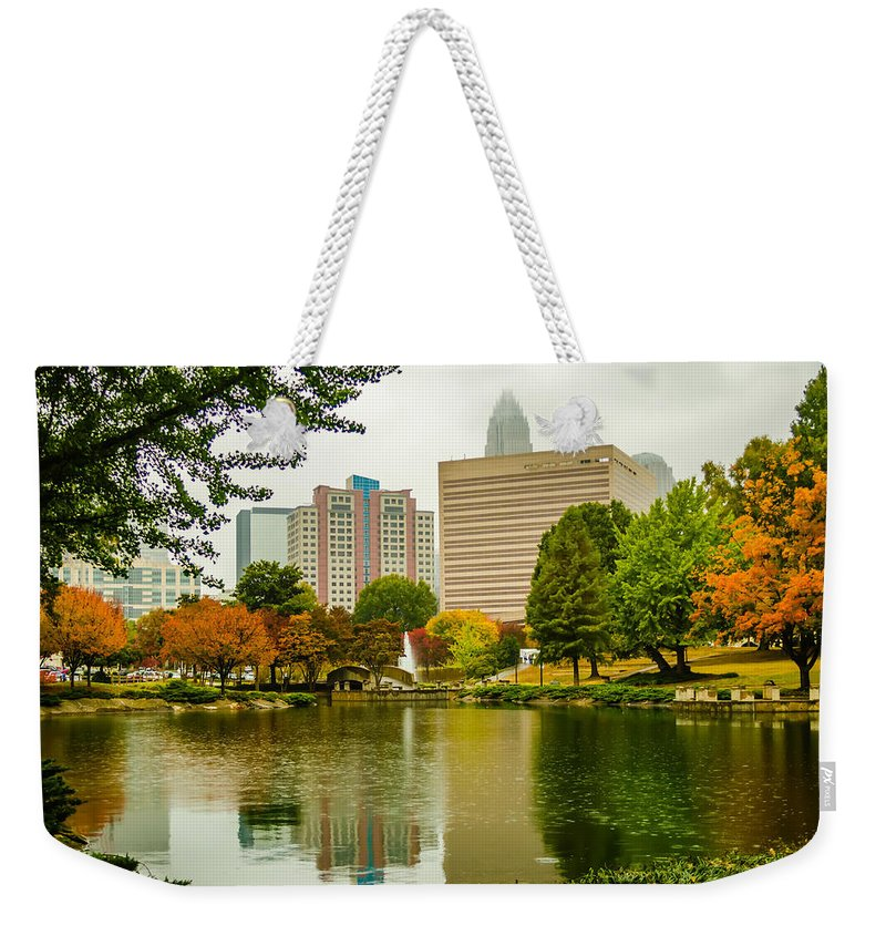 And Rainy Weekender Tote Bag featuring the photograph City Skyline In Fog And Rainy Weather During Autumn Season by Alex Grichenko