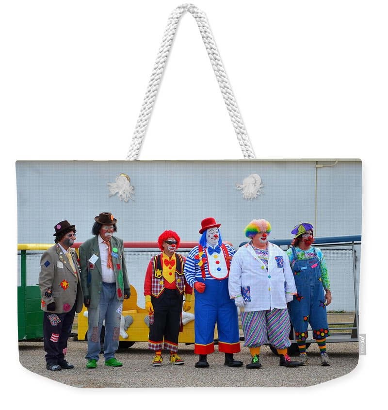 Clown Weekender Tote Bag featuring the photograph Clown Lineup by Darrell Clakley