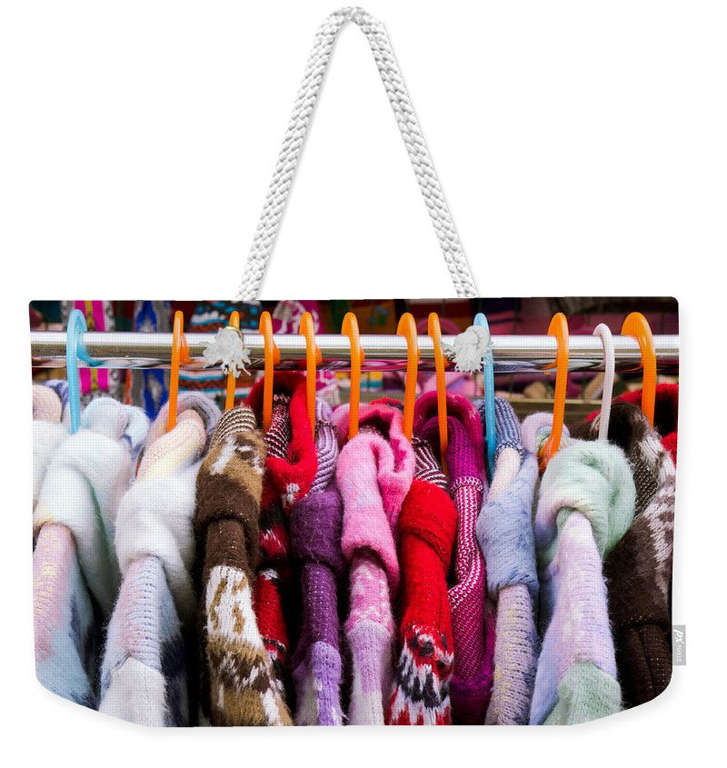 Blue Weekender Tote Bag featuring the photograph Colorful Coats by Tom Gowanlock