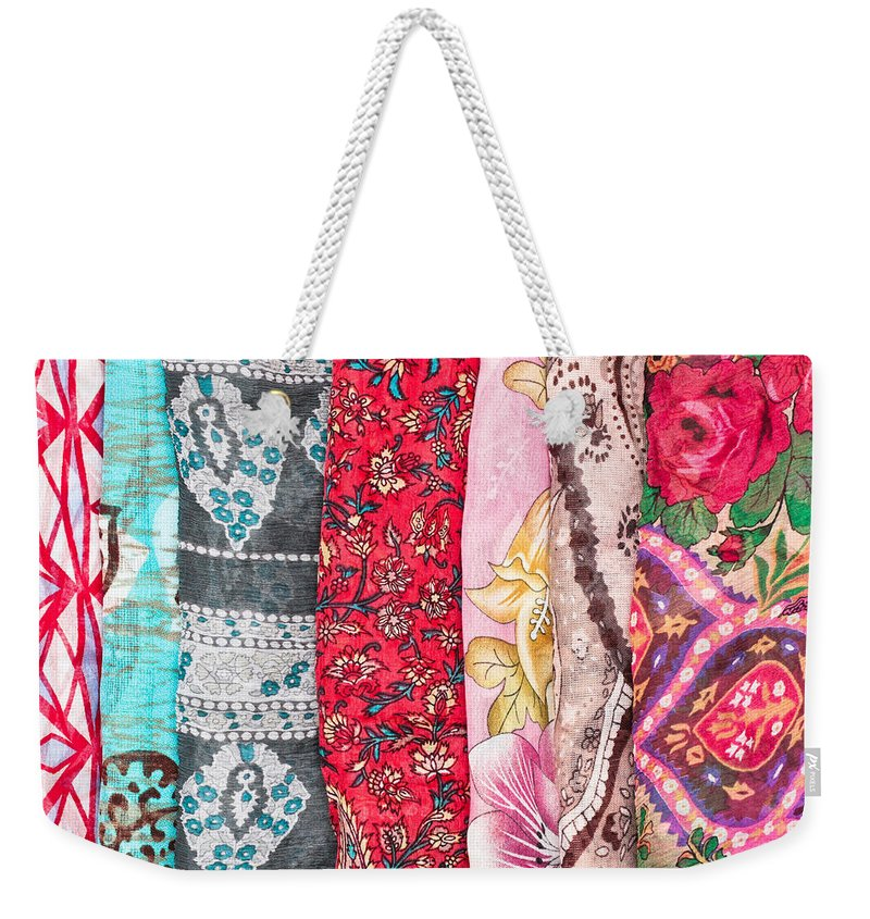 Accessory Weekender Tote Bag featuring the photograph Colorful Scarves by Tom Gowanlock