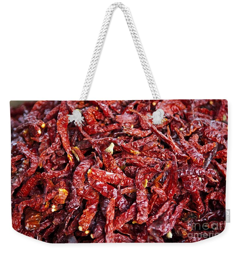 Malaysia Weekender Tote Bag featuring the photograph Dried Chilli by Tim Hester