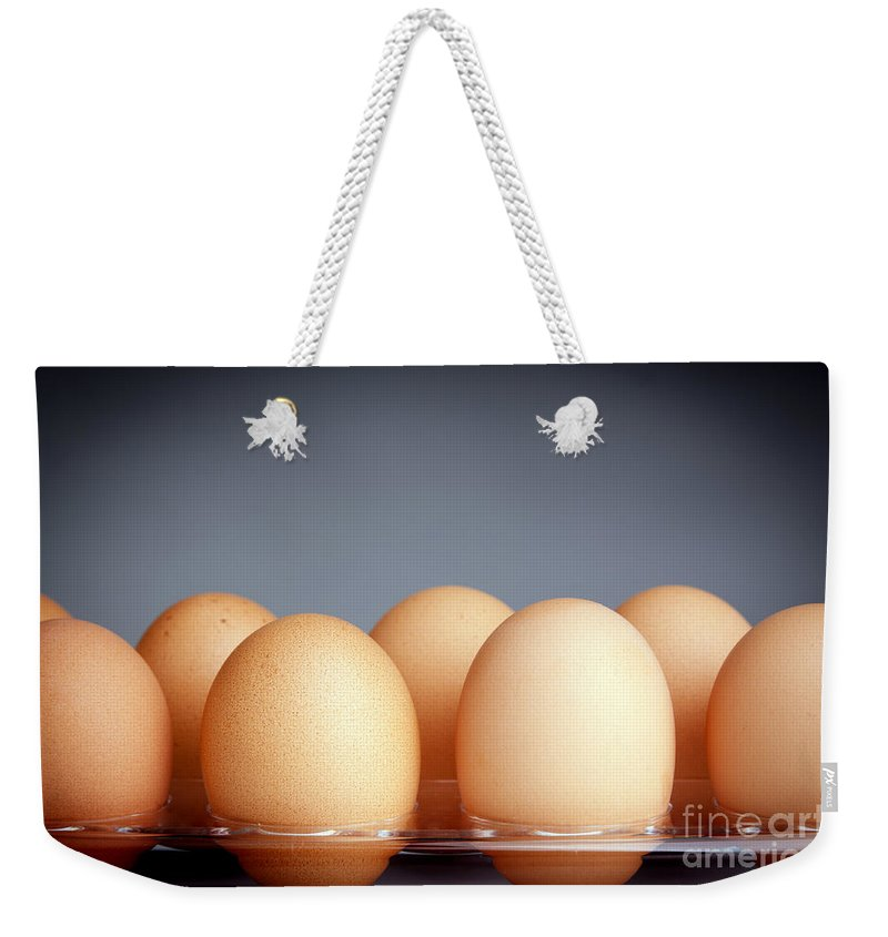 Carton Weekender Tote Bag featuring the photograph Eggs by Tim Hester